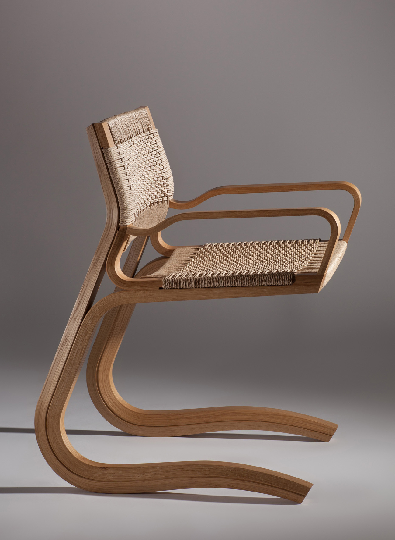 Stephen O'Briain, FUSION II Carver, oak with Danish cord woven seat, H 82 x D 67 x W 53cm,€1,800 (can be ordered with a split cane seat)