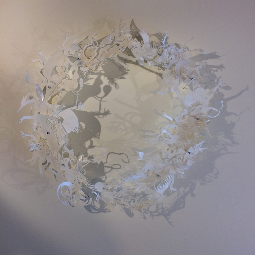 Nicole Tilley, Beneath Her Fleeting Wings The Dragons Roar, paper sculpture assemblage with mother of pearl leaves
